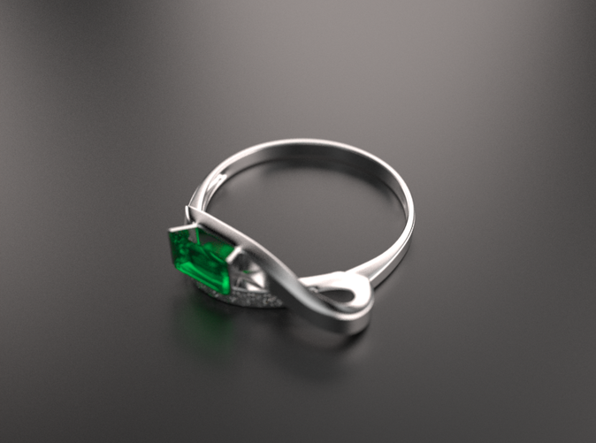 Beautiful ring with emerald-type gem