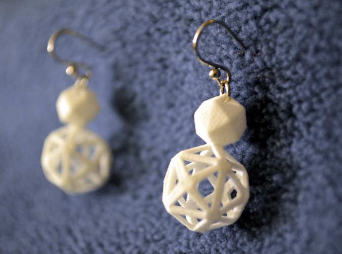 Polyhedron snowman earring pair with silver hooks.