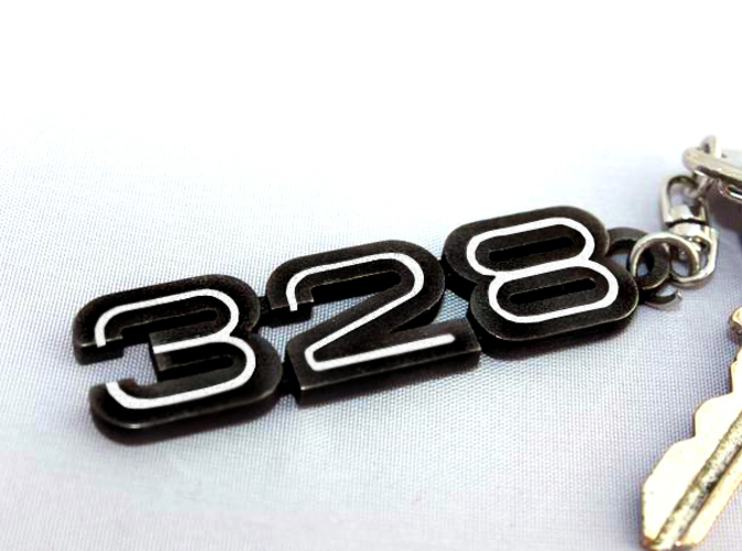 Keychain with the 328 logo in Matt Black Steel with white inserts
