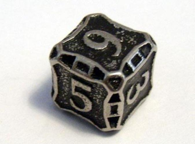 A Die6 in stainless steel and inked.