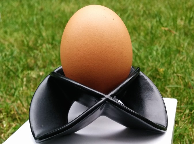 Satin black ceramics, with egg