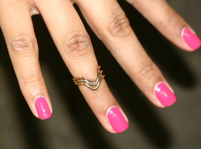 White, yellow and pink shown on a hand
