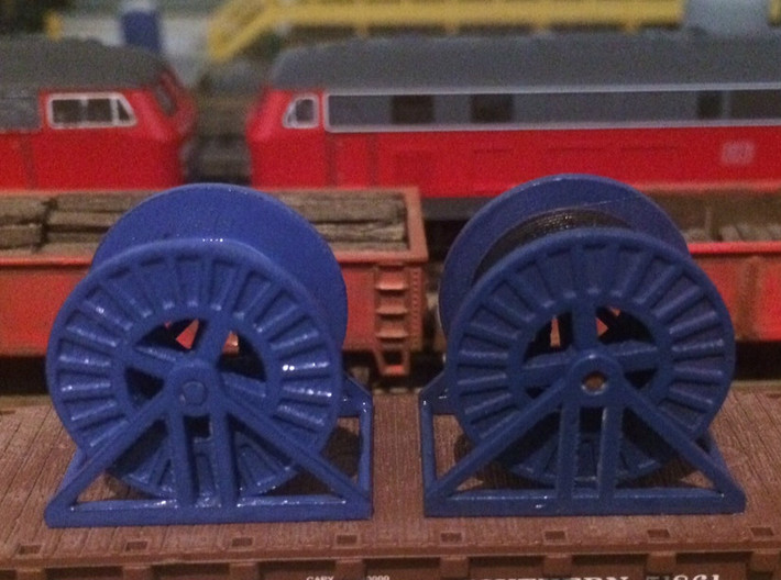 N Scale Steel Cable Reel (Empty) 3d printed Steel acble reels (empty on the left) in Frosted Ultra Detail