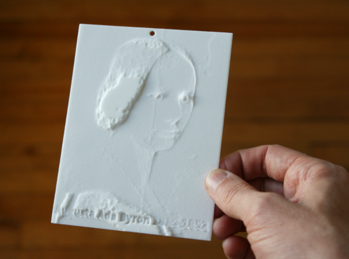Ada Lovelace Shadowgram 3d printed Photo of the print lit from the front, revealing the relief