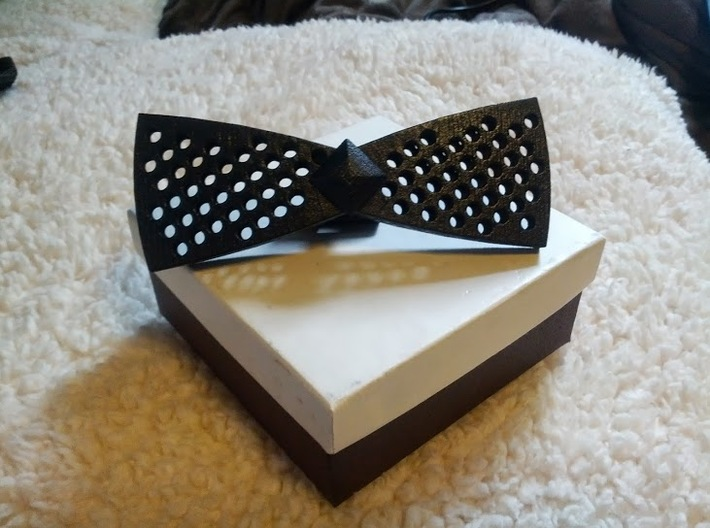 Spinning bow tie - rounded holes 3d printed