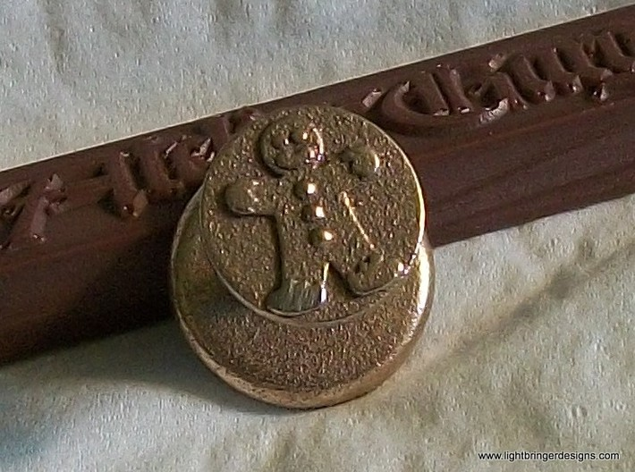 Gingerbread Man Wax Seal 3d printed Gingerbread Man Wax Seal in Stainless Steel, shown with a stick of Gingerbread Brown sealing wax