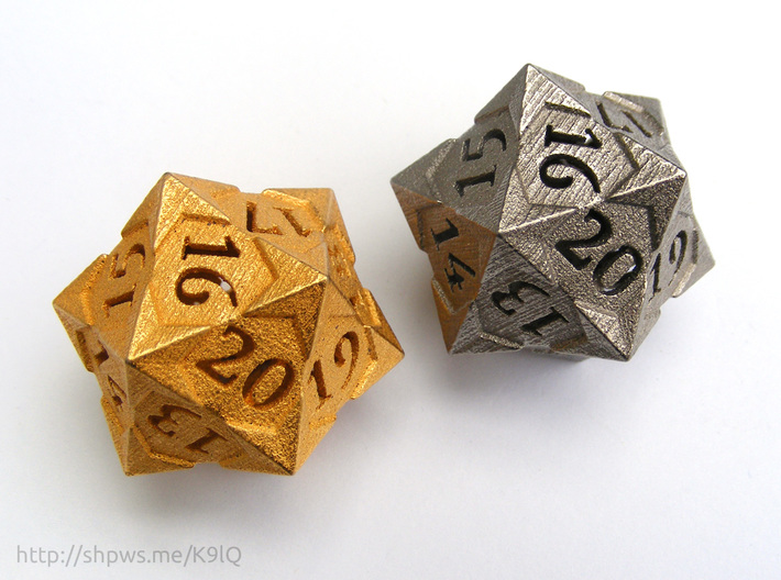 'Starry' D20 Spindown Life Counter Die 3d printed Polished gold steel (left), and polished nickel steel (right).
