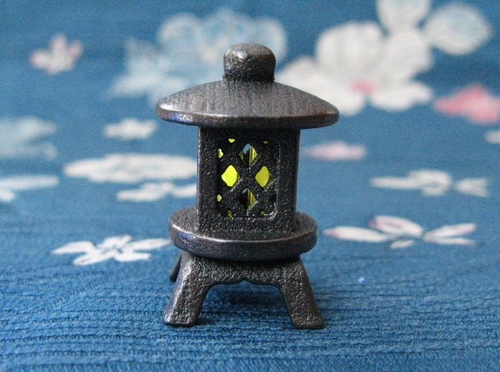 Japanese Stone Lantern A: Tritium (All Materials) 3d printed In this picture the phosphorus coating on the tritium vial is being energised by UV light.