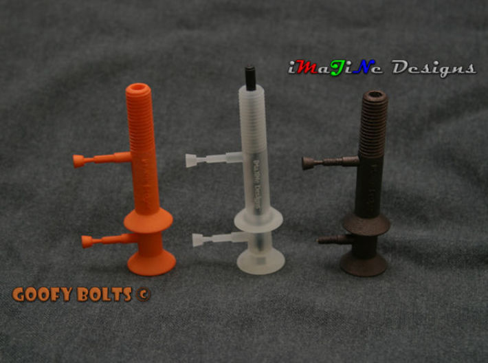 "Goofy Bolt-01-Jan-2016 Cutaway 3d printed Prototypes (Orange Strong & Flexible Polished, Frosted Ultra Detail, Matte Bronze Steel).  A 4mm [5/32""] rod illustrates how the optional mounting method is used.  Hole Plugs still attached to the prints."