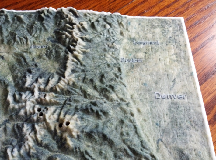 Colorado Fourteeners with holes, 12'' 3d printed Photo of actual print, focusing on Denver area; note holes for Mt Evans and Bierstadt in the lower-middle area