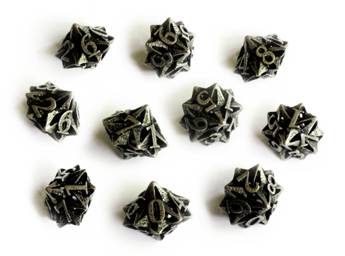 10d10 Pinwheel Set 3d printed In stainless steel and inked.