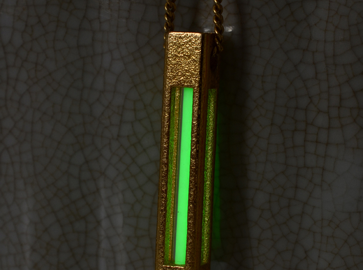 A Tritium Pendant 3d printed Pendant with green vial.