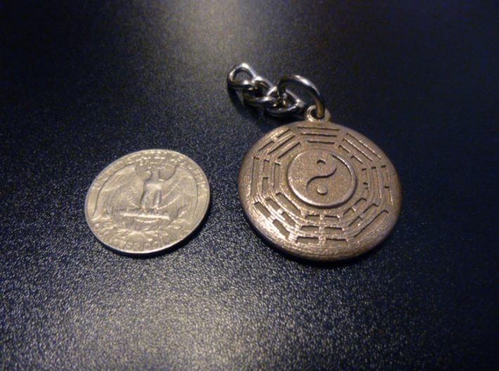 Yin Yang Keychain/Pendant with Fuxi Bagua 3d printed Stainless Steel keychain next to a standard US quarter