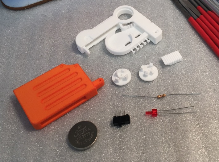 Prop Holotape, White Parts, 1 of 2 3d printed Parts before dying and assembly. Orange parts and electronics sold separately.