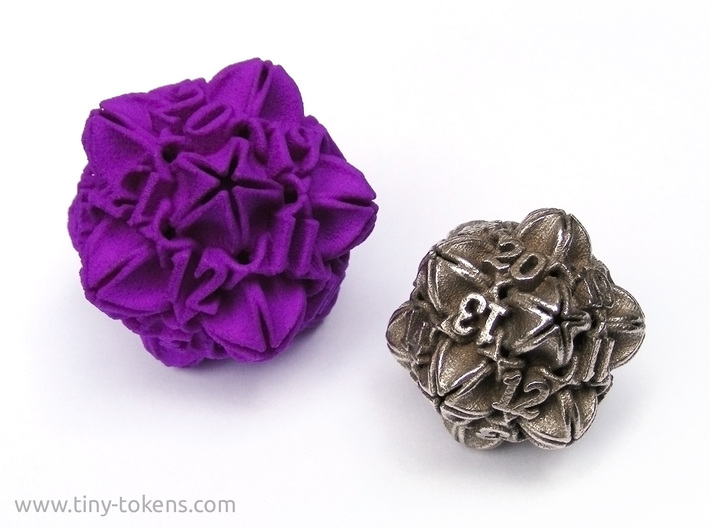 Floral 2 - D20 balanced gaming die 3d printed An example of the size difference between the plastic and metal version. (Please not that the dice shown are the spindown variants.)