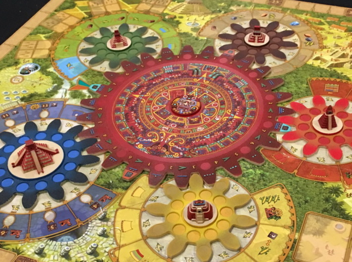 Mayan Pyramids and Calendar center (6 pcs) 3d printed White Strong Flexible, hand-painted. Photo courtesy of SlikkRikk (on BGG). Painted by user geosan (on BGG). Game cogs copyright Czech Games / Iello.
