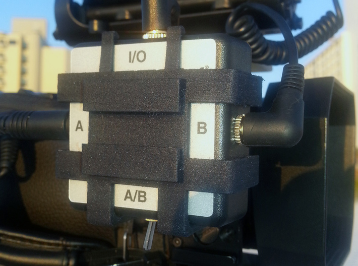 Camera Mount For Sescom Audio Switch With Clip Bar 3d printed A photo of the prototype print in black nylon.