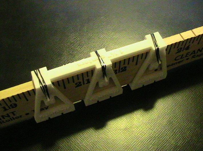 """TrackToolz 1 1/2"""" Track Spacing Jigs 3d printed Three track spacer in use with the gauges"""