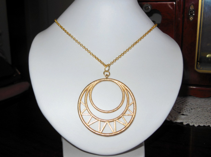 Circles Pendant 3d printed Photo of the pendant from Polished Gold Steel