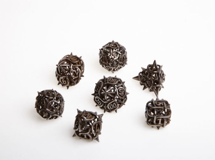 Thorn Dice Set with Decader 3d printed In polished grey steel.