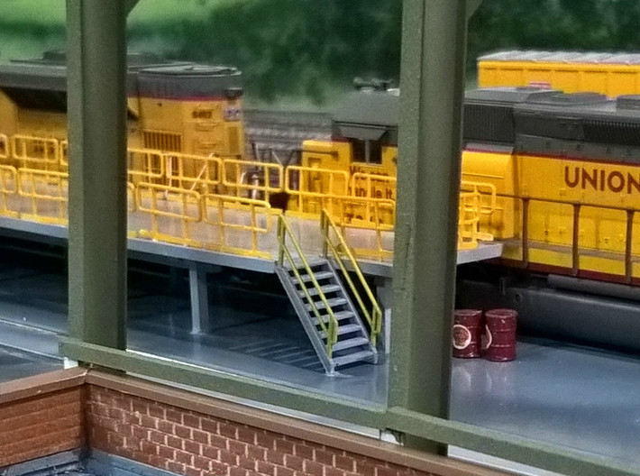 HO Maintenance Railings 4x25 3d printed The #8 stairs and maintenance railings at the Chippewa, Marquette, St. Charles and Pacific RR locomotive facility. Thanks for the picture Greg!!