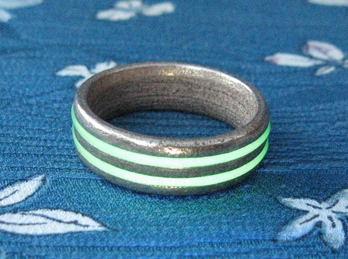US13 O-Ring Ring: Glow (Stainless Steel) 3d printed In this picture the phosphorescent powder in the o-ring is being energised by UV light.