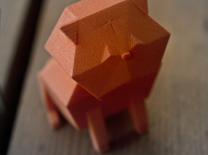 Folded Sculpture Dogs, Pugs 3d printed Strong flexible plastic in orange, closeup view at face