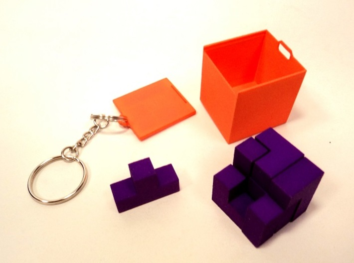 Small SOMA cube fits in the Box (a separate produc 3d printed Small SOMA cube (assembled tetrahedron 2.7x2.7x2.7 cm) can be fitted in the Box connectable to a keychain