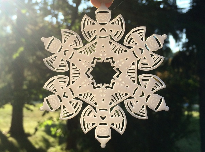 Snow Angel Snowflake Ornament 3d printed from afar it looks like a pretty snowflake, but look closer to see an image of a child making a snow angel :)