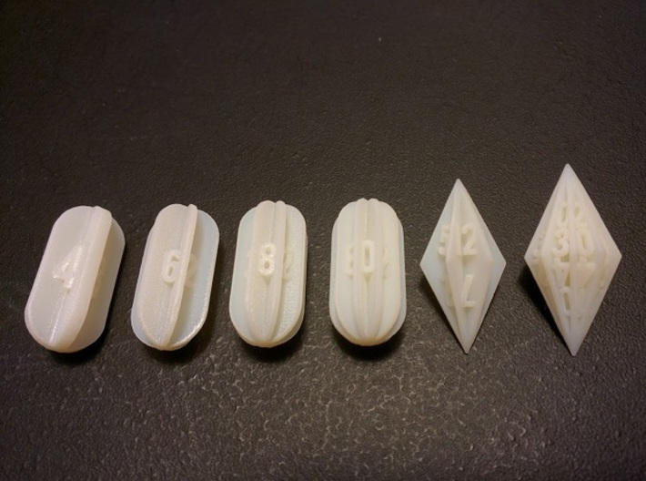 Radial Fin Dice 3d printed 6 dice from the seven die set in white acrylic