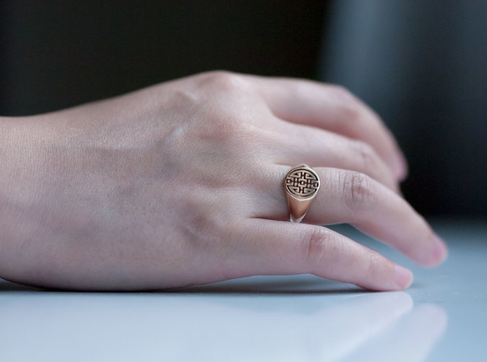 Happiness - Lady Signet Ring 3d printed Polished Bronze on a Ring Finger
