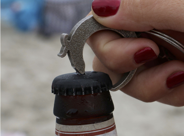 Otter Bottle Opener Keychain 3d printed In Action