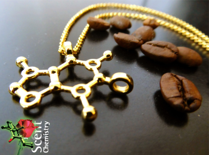 Caffeine 3d printed Caffeine pendant on an 18k gold-plated Thomas Sabo  KE1219-413-12-L42v necklace with a few freshly roasted coffee beans.