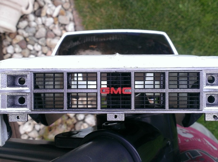 1982 GMC Grille For Tamiya Clodbuster (2/4) 3d printed Complete grille (all four parts)painted and installed on Tamiya Clodbuster body