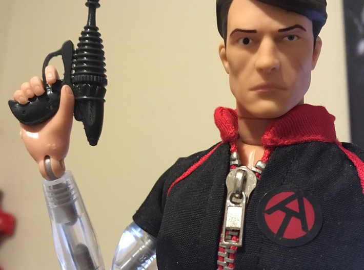 Saturn-day Night Special Ray Gun 1:6 scale 3d printed Seen here with Mike Power, Atomic Man, in Black Hi-Def Acrylate