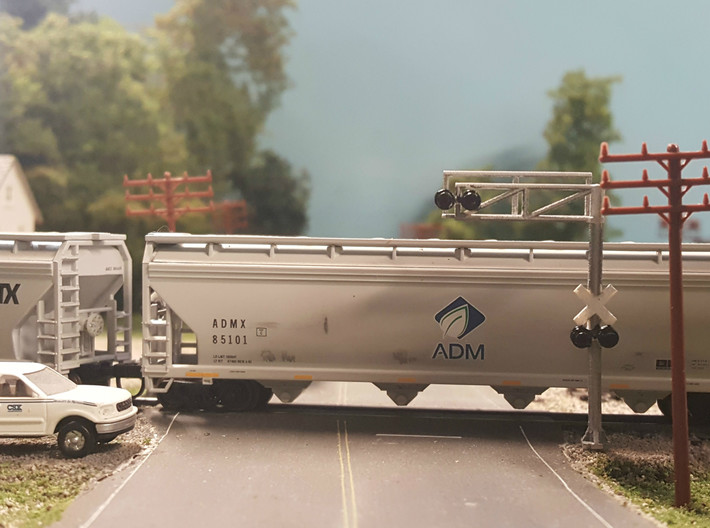N Scale Crossing Gantry 1 Lane 4pc 3d printed Painted gantry installed in an excellent scene. Thanks for the picture Adam!