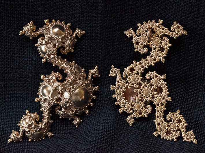 Dissected Dragon Pendant 3d printed Front and back. Revealing thee inside of the kleinian fractal.