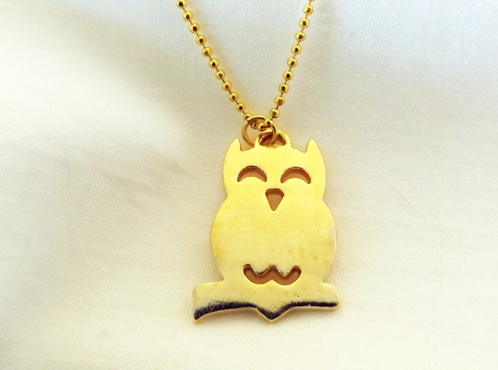 Hooting Owl in Tree™ Pendant 3d printed Hooting Owl in Tree Charm shown in Raw Brass