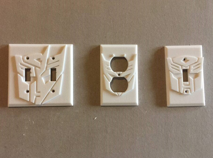 Decepticon Symbol Power Outlet Plate 3d printed All the Transformers-Themed Fixtures, in white strong and flexible