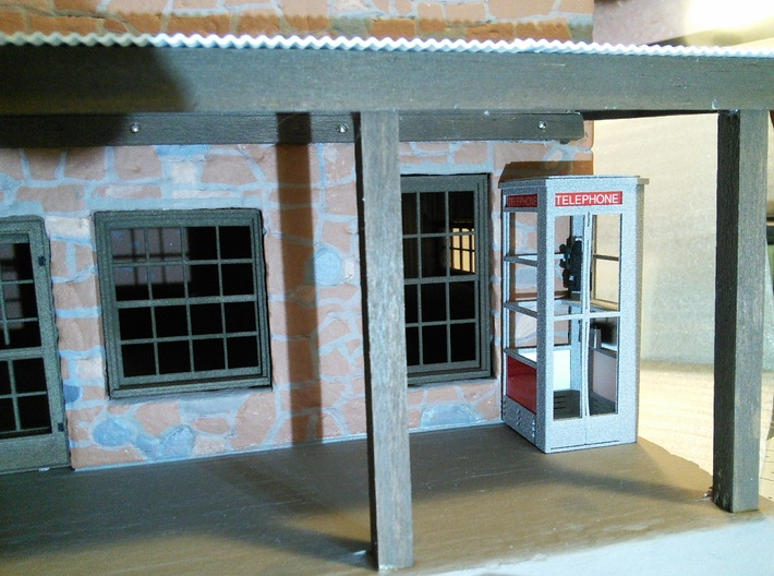 Telephone Booth, 1/32 Scale 3d printed Phone booth on front porch of 1/32 scale model building.