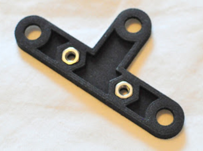 Garmin Varia mount for Topeak racks 3d printed Back side of printed bracket with M3 nuts inserted into recesses.