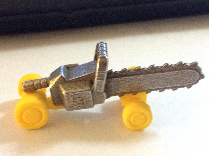Chainsaw Car, Prize Size, Part B (Undercarriage) 3d printed Both parts of the kits combined, yellow S&F undercarriage, stainless steel chassis.