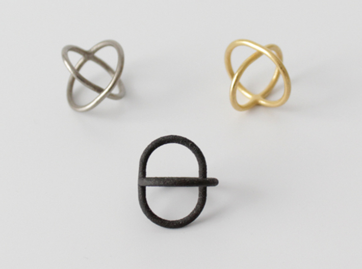 Satellite Ring  3d printed Shown in polished gold steel, matte black steel and stainless steel