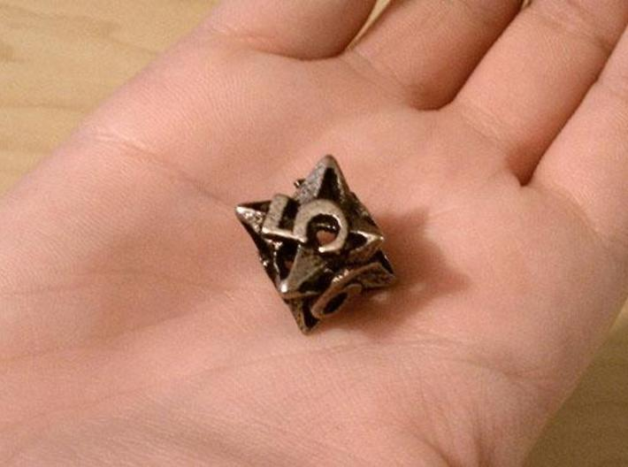 Pinwheel Die6 3d printed In stainless steel and inked.