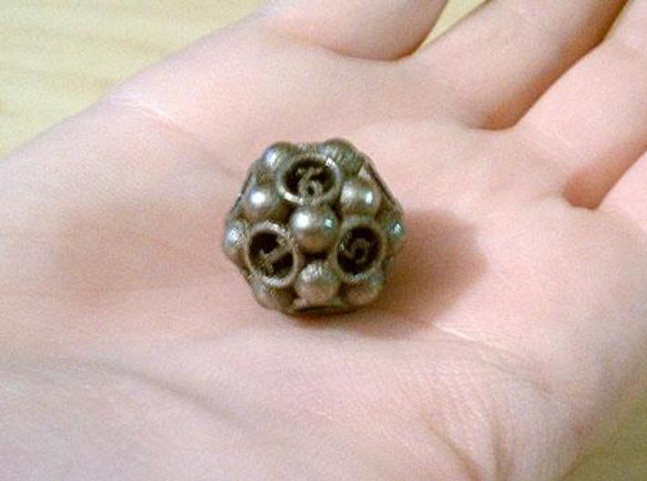 Spore Die12 3d printed In stainless steel and inked.
