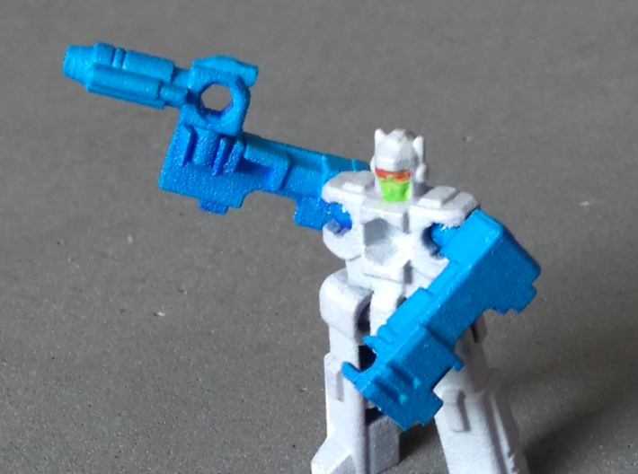 "MicroSlinger ""Squall"" 3d printed Squall robot mode, hand-wielding his blaster accessory."