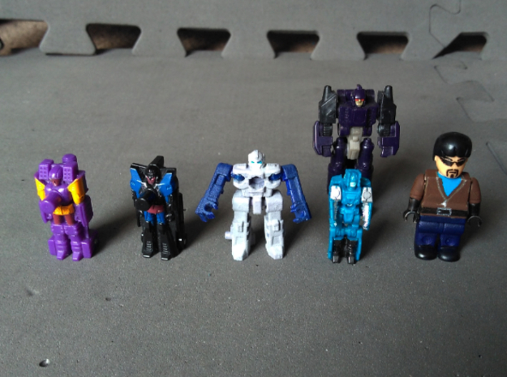 """MicroSlinger """"Mayhem"""" 3d printed With small Transformers and a minifig to illustrate scale."""