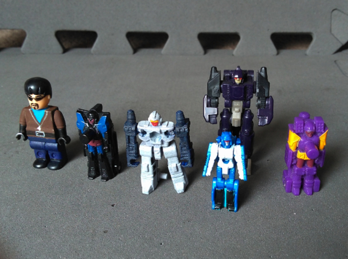 """MicroSlinger """"Uproar"""" 3d printed With small Transformers and a minifig to illustrate scale."""