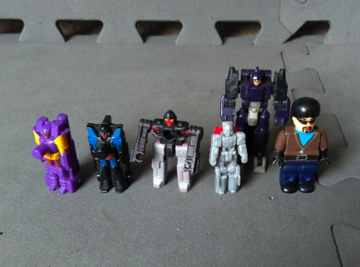 """MicroSlinger """"Flarestorm"""" 3d printed With small Transformers and a minifig to illustrate scale."""