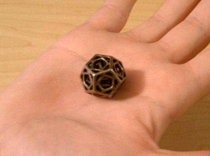Cage Die12 3d printed In stainless steel and inked.